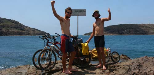 Tim and Dan Wills at Cape York after cycling 5300km (1/10/2003)