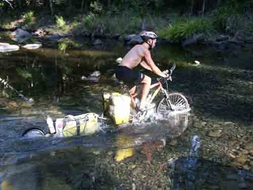 Dan, cycling across a creek